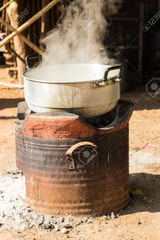 3/11/18-3/17/18 38642693-boiling-water-in-traditional-old-pot-on-charcoal-stove-brazier-stock-photo