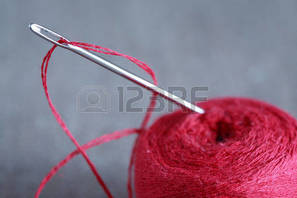 4/15/18-4/21/18 27012113-sewing-concept-extreme-closeup-of-steel-needle-with-red-thread